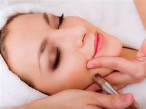 A client undergoing microdermabrasion in Fort Myers, FL.